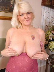 Busty fingering mature