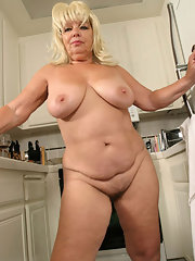 Gorgeous blonde milf spreads legs
